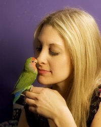 Nikki Moustaki and parrot